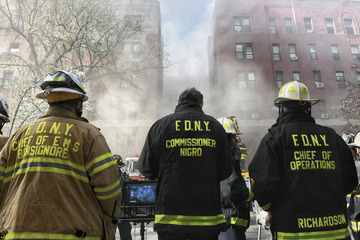 Hundreds of firefighters are battling a devastating apartment building blaze in Queens