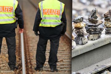 Vater legt mit Söhnen Steine auf Bahnschienen: Als der Zug kommt, geht die Aktion nach hinten los