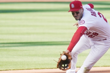 MLB: The Cardinals outlast a late rush by the Rockies to win at home