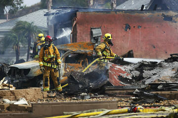 Plane crashes into home and UPS truck in San Diego area, killing at least two people
