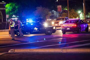 Charges dropped against two teens in Downtown Austin shooting, new suspect at large