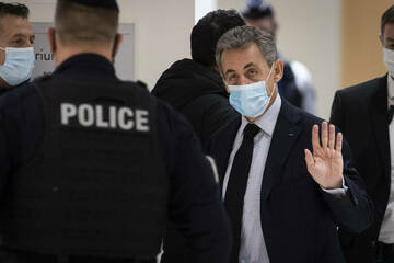 Former French president Sarkozy sentenced to three years in prison for bribery