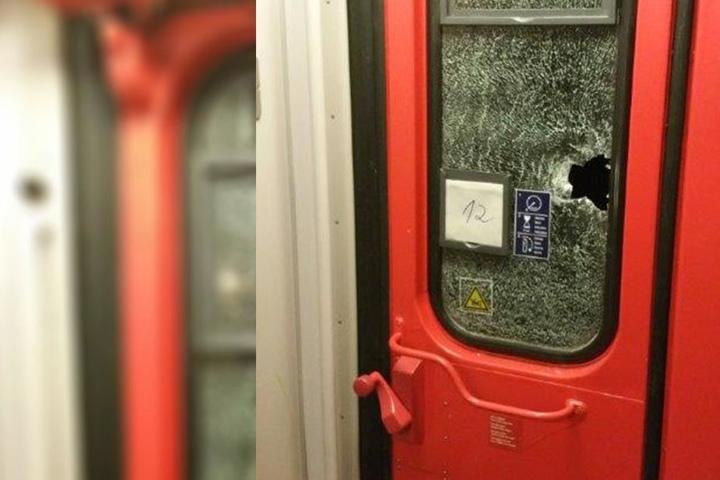 Die Scheibe einer Tür des Zuges wurde von einem Stein durchschlagen.