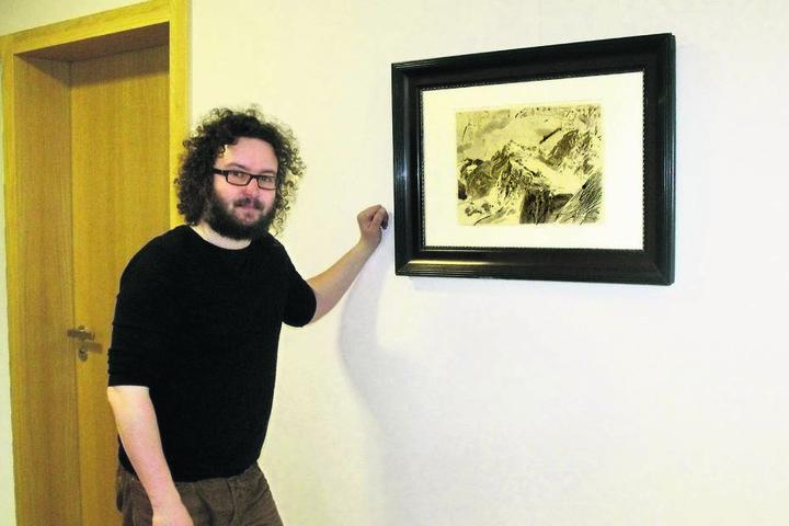Künstler Robert Schmiedel (45) mit dem damals gestohlenen Bild. Es ist  verschollen.