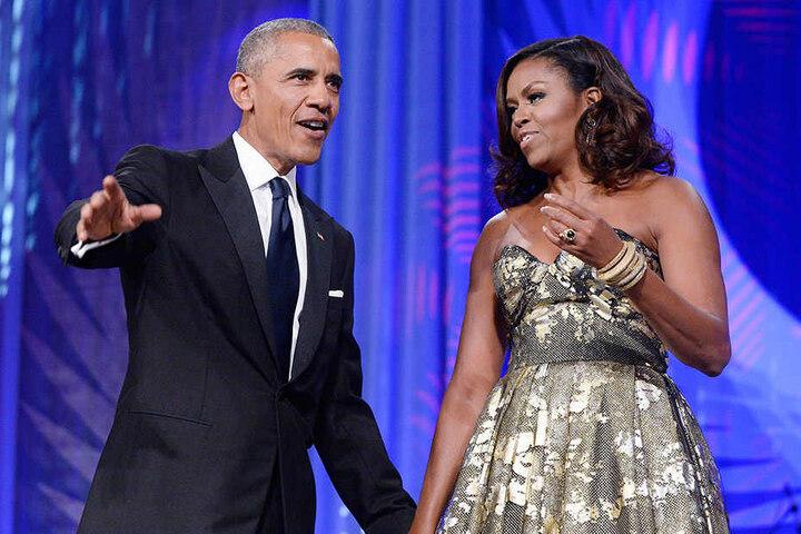 Barak Obama  (links) mit seiner Gattin Michelle.