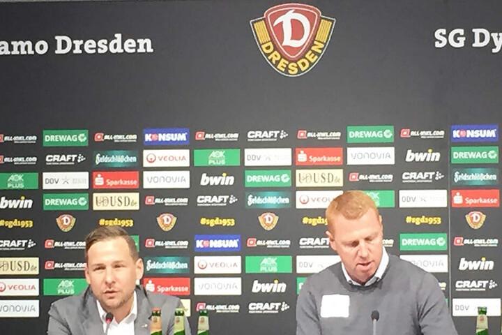 SGD-Chefcoach Maik Walpurgis (rechts) spricht auf der PK zu den Journalisten. Links Pressesprecher Henry Buschmann.
