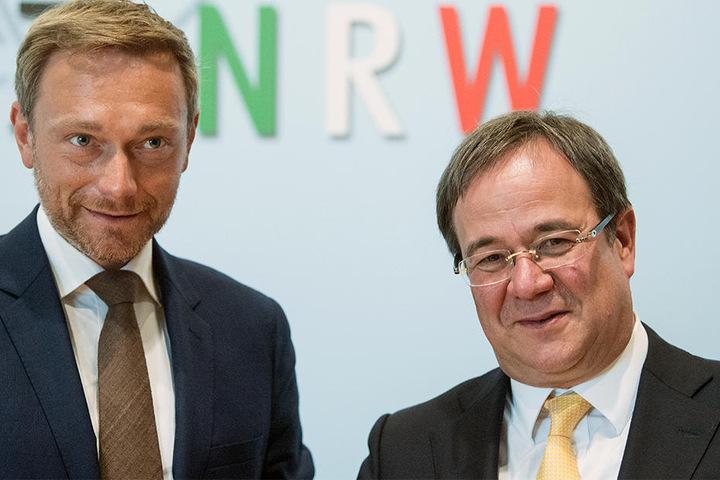 Christian Lindner (links, FDP) und Armin Laschet (CDU) sollen sich für alle Arbeitnehmer einsetzen, fordert der DGB-Landeschef.