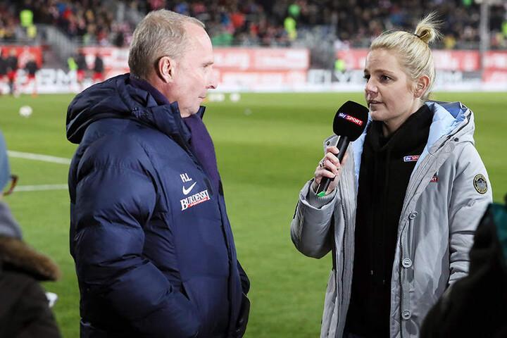 FCE-Präsident Helge Leonhardt (l.) ist bei den TV-Interviews um keine Antwort verlegen.