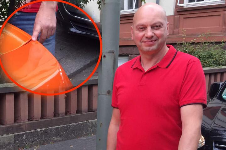 Markus Zahn, Besitzer des Wagens, zeigt auf die Stelle, in die der Esel gebissen hat.