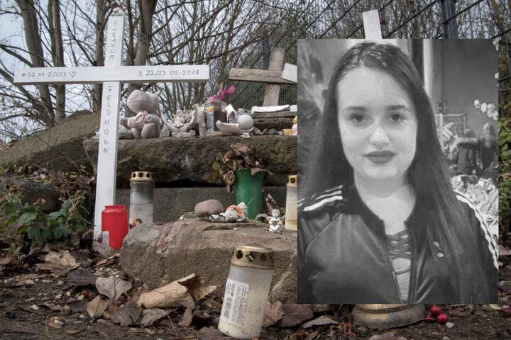 Holzkreuze, Grablichter und Engelsfiguren aus Gips erinnern an einer improvisierten Gedenkstätte an die getötete Susanna (Fotomontage).