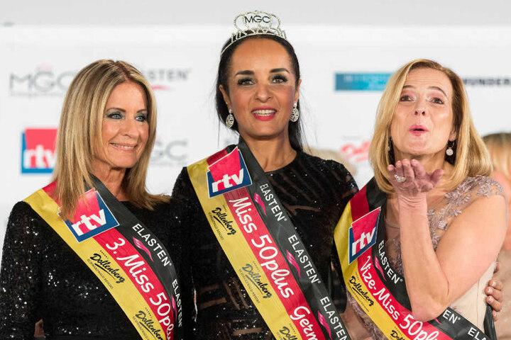 Siegerin Manuela Thoma-Adofo (MItte) mit Anja Franziska Gause (rechts, Zweitplazierte) und Michaela Büßecker (links, Drittplazierte).