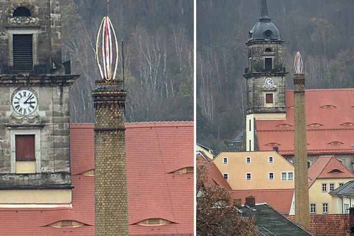 Dieser befindet sich am Schlund des Schornsteins vor der Evangelischen Stadtkirche.