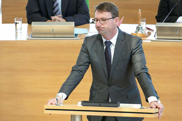 Innenminister Roland Wöller (47, CDU).