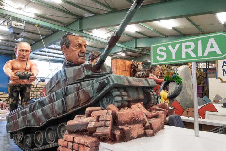Auf einem Panzer sitzt der türkische Präsident Recep Tayyip Erdogan und wird vom russischen Präsidenten Wladimir Putin gesteuert.