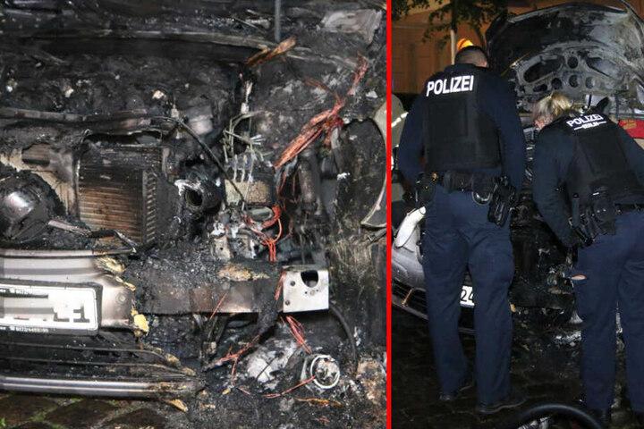 Die Polizei inspiziert den abgebrannten Mercedes in Neukölln.