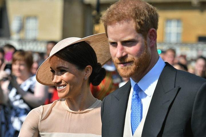 Prinz Harry (33) und Herzogin Meghan (36) kommen zu einem Gartenfest im Buckingham Palace.