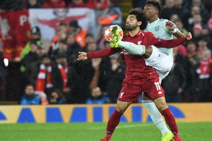David Alaba (r.) und der FC Bayern München erarbeiteten sich an der Anfield Road ein Remis.