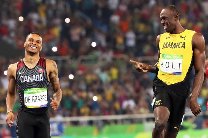 André De Grasse und Usain Bolt zogen locker ins Finale ein.