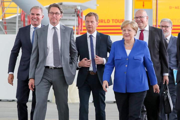 Besuchten die erste Nationale Luftfahrtkonferenz auf dem Flughafen Leipzig-Halle (v.l.n.r.): Carsten Spohr, Lufthansa-Vorstandsvorsitzender, Bundesverkehrsminister Andreas Scheuer (CSU), Sachsens Ministerpräsident Michael Kretschmer (CDU), Bundeskanzlerin