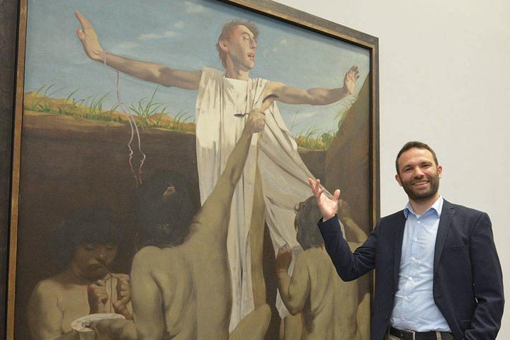 "Dr. Stephan Dahme vor dem Gemälde ""Die Erziehung Alexanders""."