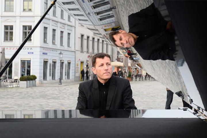 Straßenmusiker Arne Schmitt (47) sah seine künstlerische Freiheit eingeschränkt und verklagte daher die Stadt Dresden.