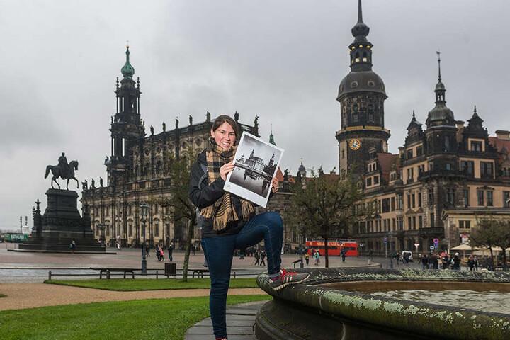 Naomi (25) mit dem Kalender, den  es heute mit der Morgenpost gibt. Er zeigt zwölf Dresdner Fotografien der 30 bis  70er Jahre.