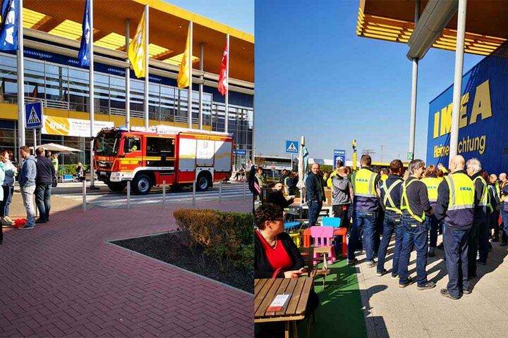 Eine Einsatzfahrzeug der Feuerwehr ist vor Ort (li.), während Mitarbeiter und Kunden vor dem Gebäude warten.