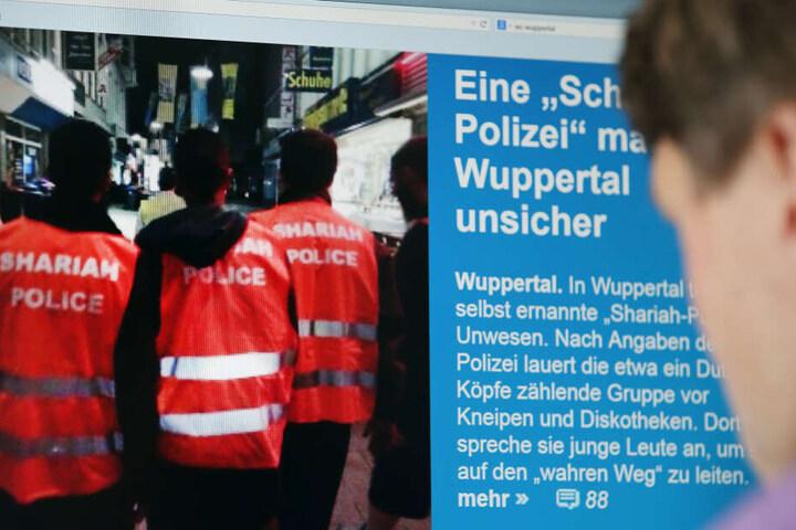 """Vor fünf Jahren waren Islamisten unangemeldet und in Warnwesten mit dem Aufdruck """"Shariah Police"""" nachts durch Wuppertal gezogen."""