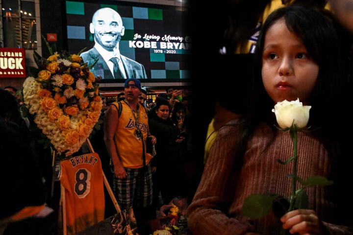 Sportler der NBA würdigten Kobe Bryant mit einer Gedenkveranstaltung. Ein Mädchen hält in Gedenken an ihr Idol eine Rose in der Hand.