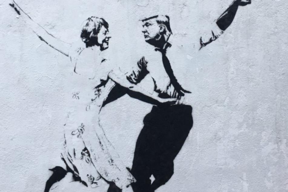 Straßenkünstlerin disst Trump und May mit diesem Graffiti