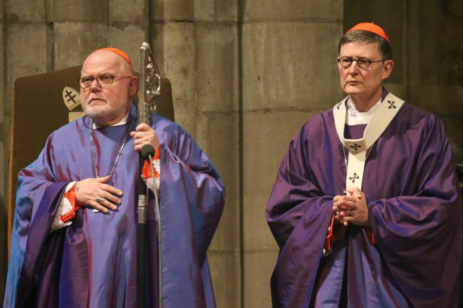 Der Vorsitzende der Deutschen Bischofskonferenz, Kardinal Reinhard Marx (l), und der Kölner Erbischof Kardinal Rainer Maria Woelki