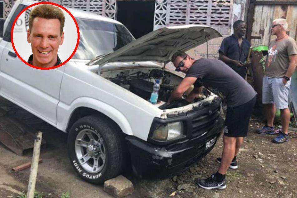 Fachmännisch macht sich Jürgen am Geländewagen zu schaffen.