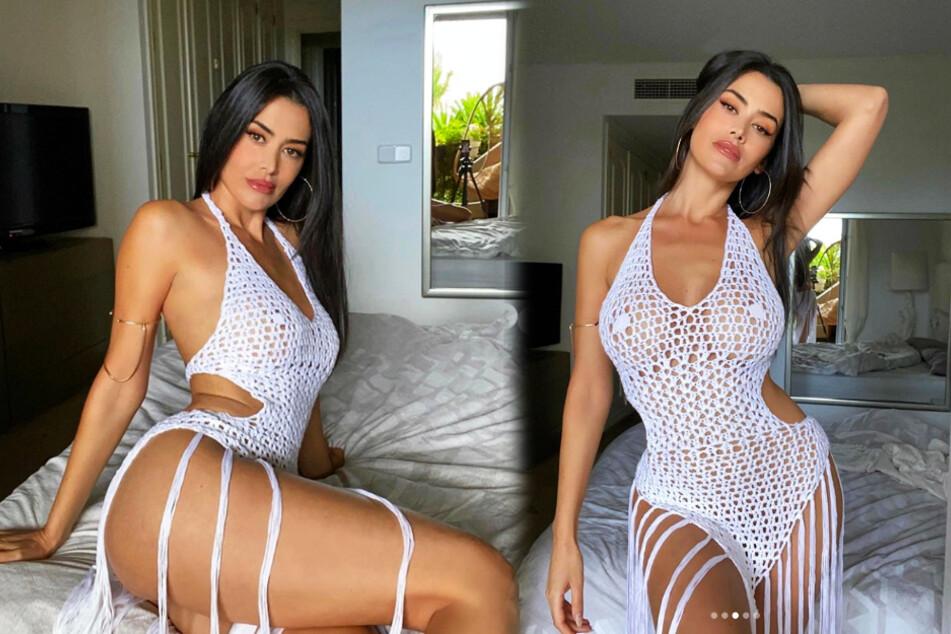 Heiße Eva zeigt im durchsichtigen Netzkleid nahezu alles!