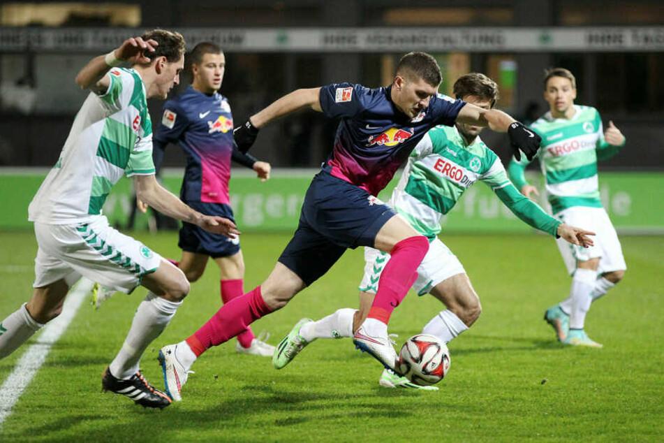 Ante Rebic (M.) spielte zur Leihe in der Saison 2014/15 in Leipzig, kam in elf Einsätzen aber zu keiner Torbeteiligung. Samstag folgt die Rückkehr.