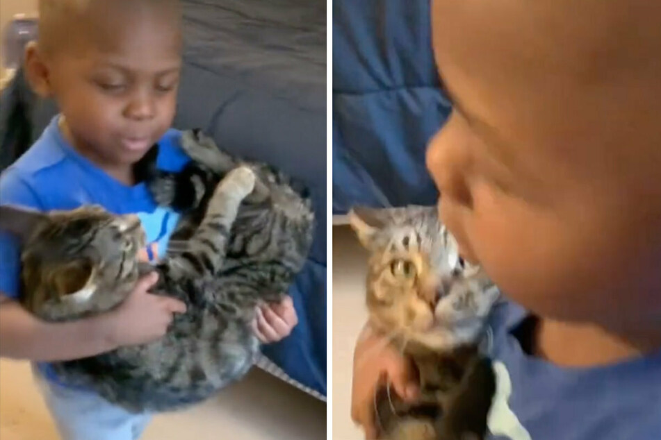 Carson (3) sings a lullaby to his pet cat.