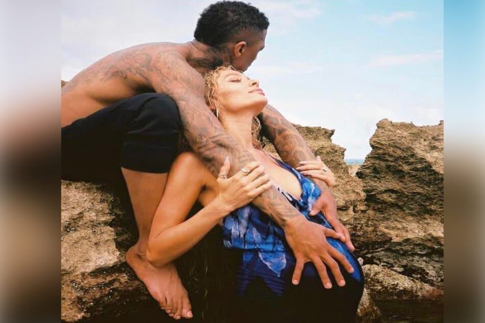 Nick Cannon (l) pictured with Alyssa Scott (r) in what appeared to be a maternity photo. The model shared the picture on Father's Day.
