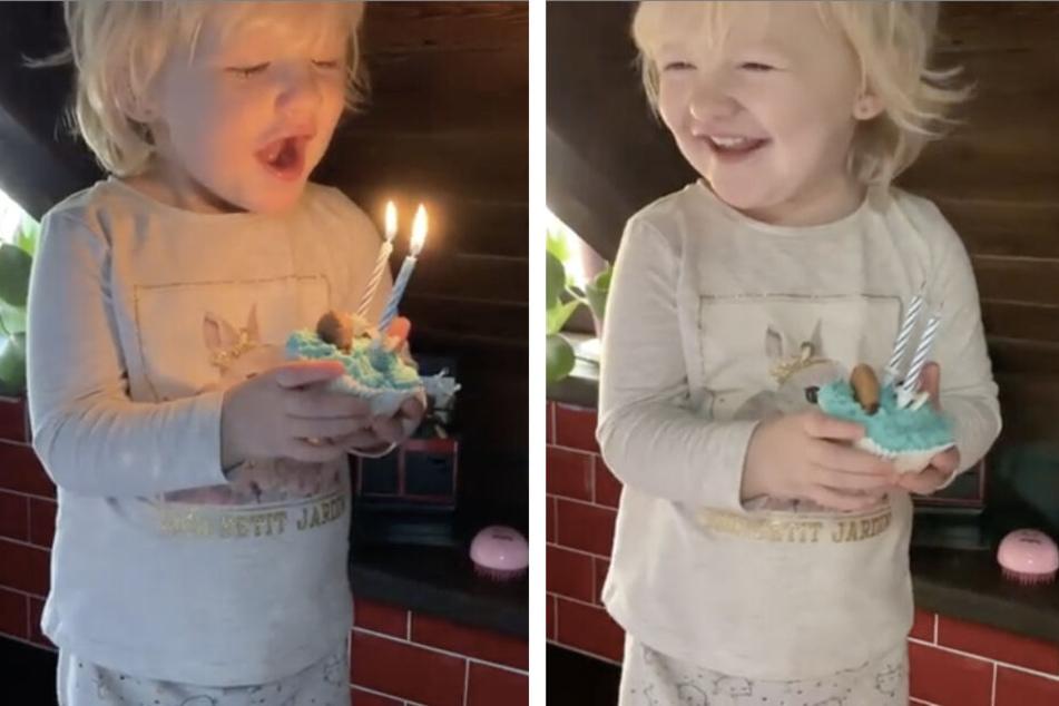 Uuund pusten! Stolz grinst die Kleine, als sie schon beim ersten Versuch die Kerzen gelöscht hat.
