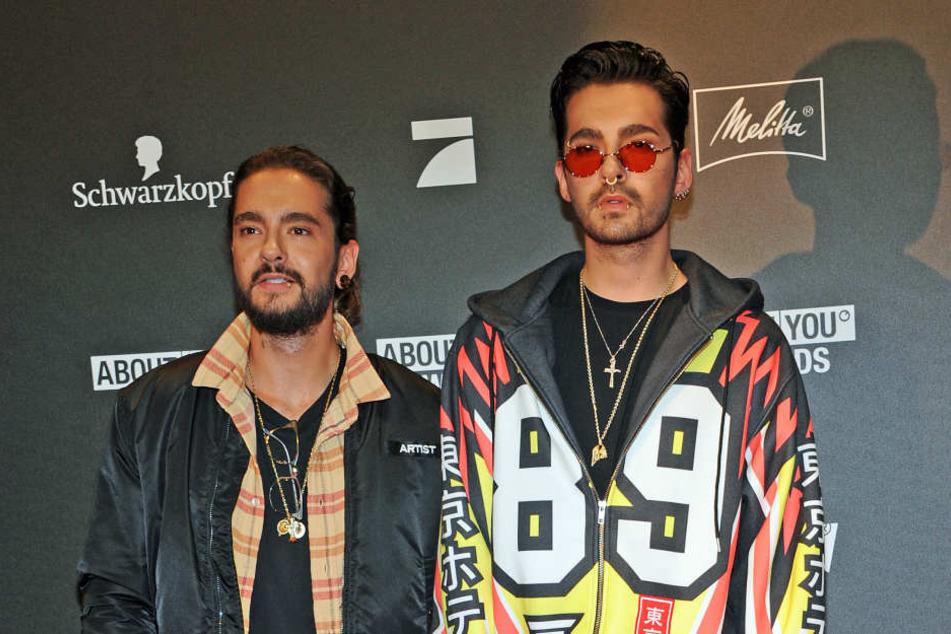 Bill Kaulitz (r.) und sein Zwillingsbruder Tom. Der kuschelt derzeit mit Heidi Klum.
