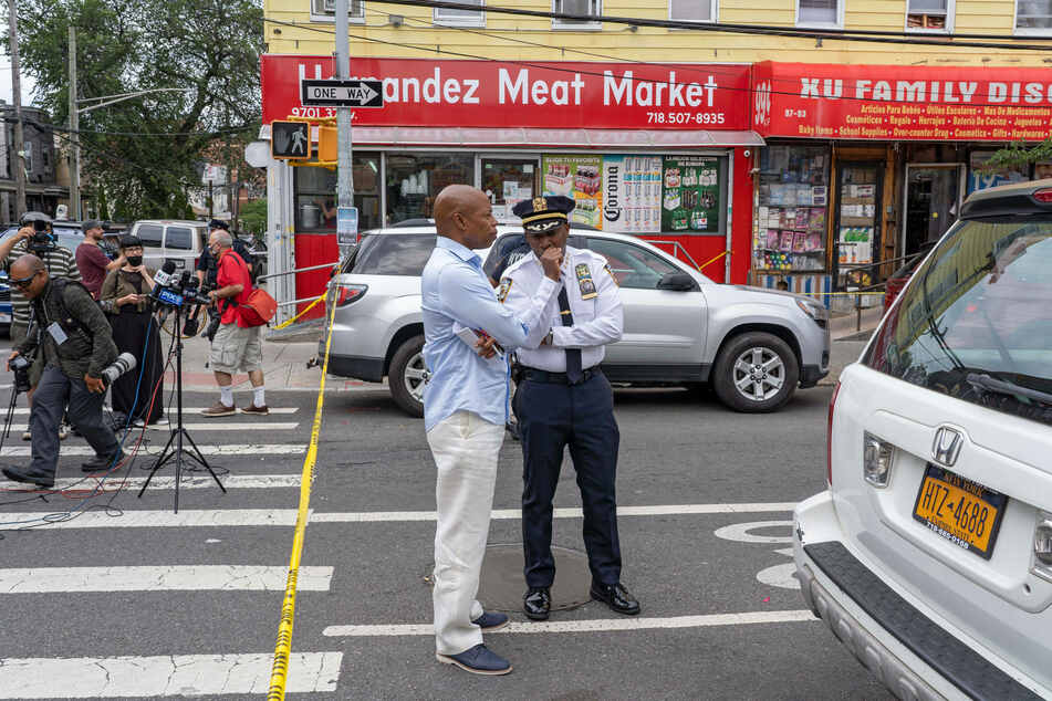 Chief of Department Rodney Harrison (r.) speaks with New York City mayoral Democratic nominee and Brooklyn Borough President Eric Adams.