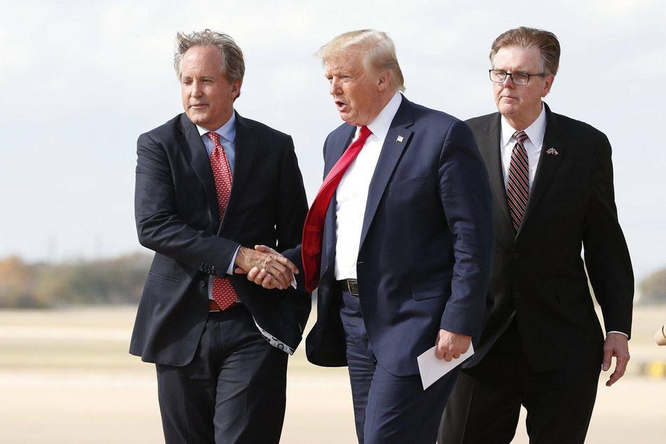 Texas AG Ken Paxton (l.) greeting President Donald Trump at Austin Bergstrom International Airport in November.