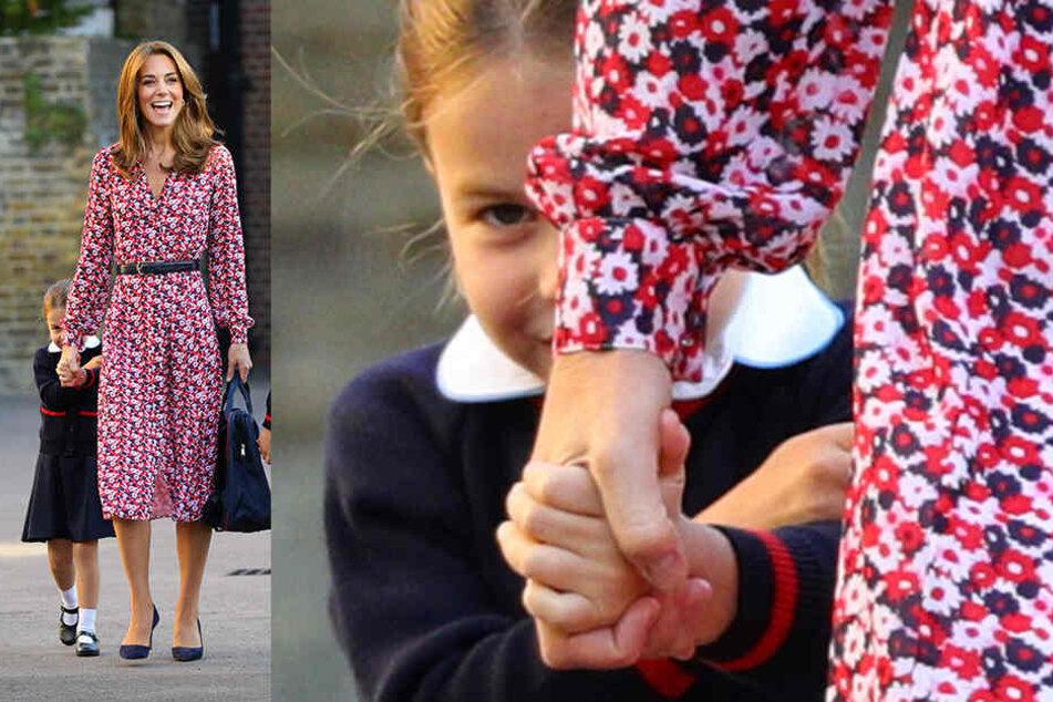 Taffes Mädchen, nur zur Einschulung dann doch ein bisschen schüchtern: Prinzessin Charlotte versucht, sich hinter ihrer Mutter, Herzogin Kate, zu verstecken.