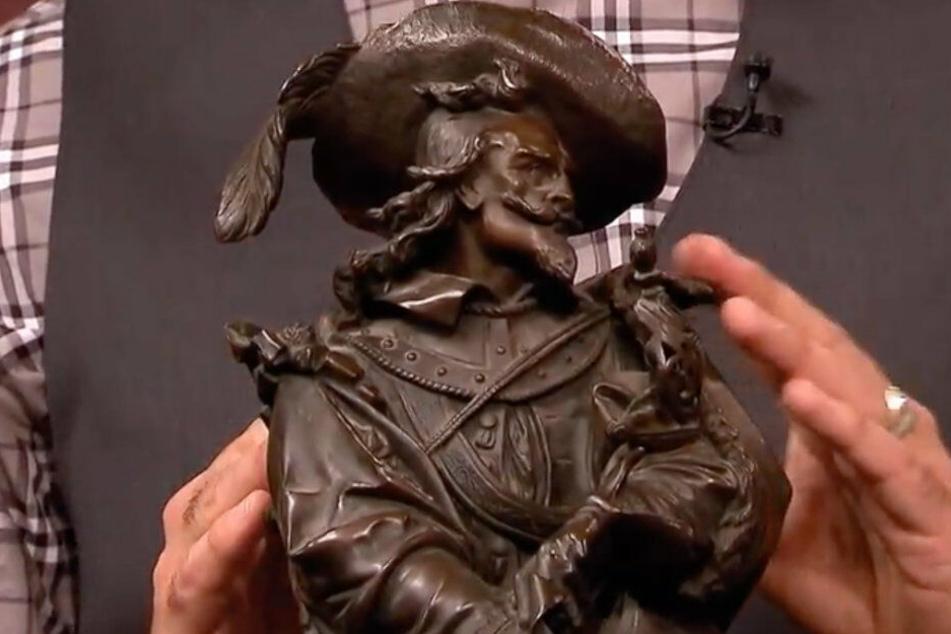 Der bronzene Musketier beglückt die Geldbörse seiner Besitzerin.