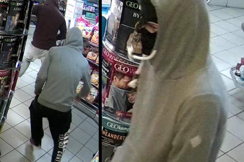 Einer der Täter trug einen grauen Kapuzen-Pullover.