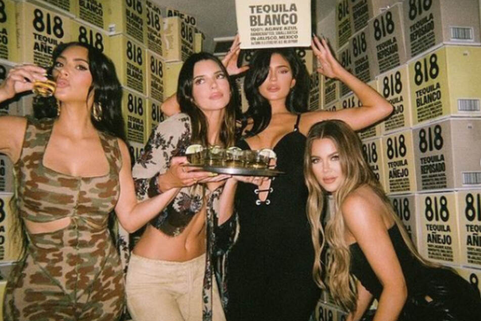 Throwing down with some big shots: The Kardashians party with hot celebs at tequila launch bash