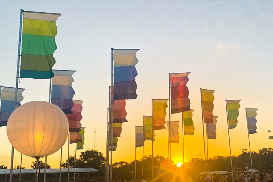 The sun sets upon the flags at Zilker Park during weekend two of Austin City Limits Music Festival.