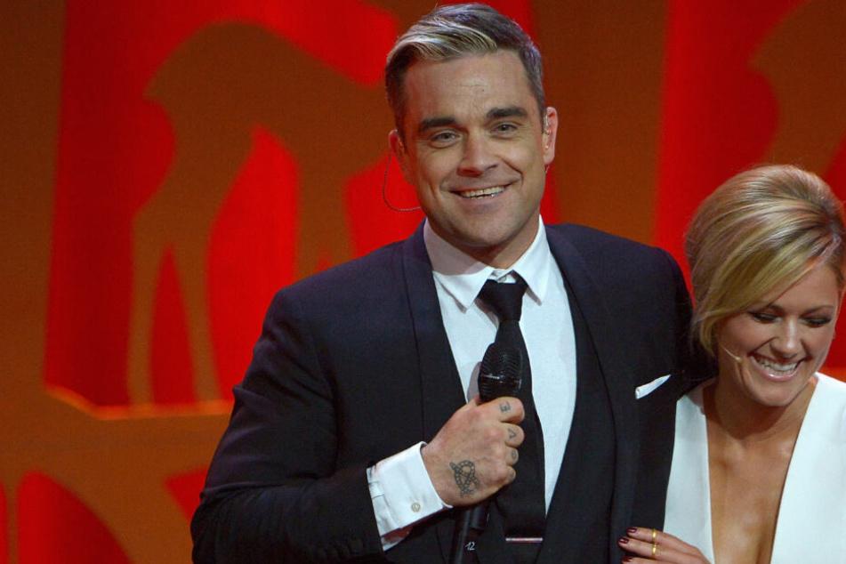 Kennen sich seit zehn Jahren: Robbie Williams (45) und Helene Fischer (35).