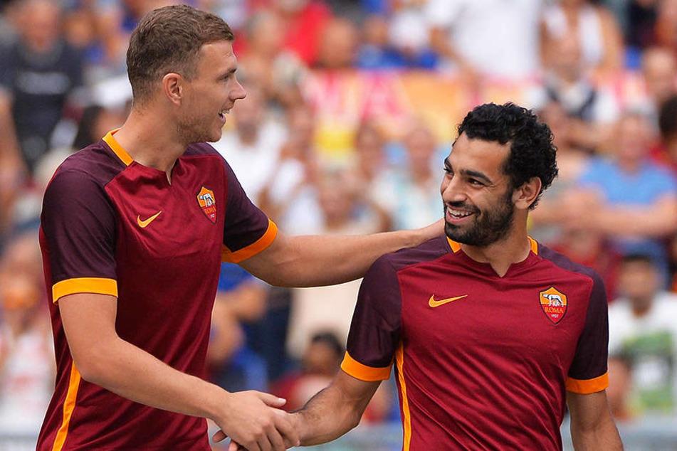 Spielten bis zum letzten Sommer zusammen und sind heute Abend Gegenspieler: Edin Dzeko (l.) und der heutige Liverpool-Spieler Mohamed Salah (r.).