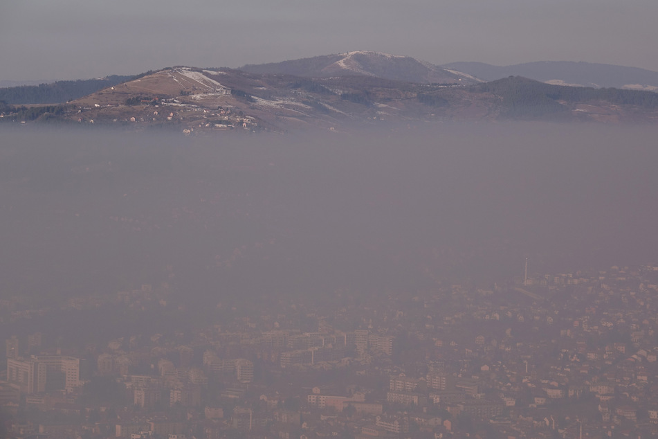 A dense haze over the Bosnian capital of Sarajevo. More than 400,000 people in the EU die every year as a result of air pollution.
