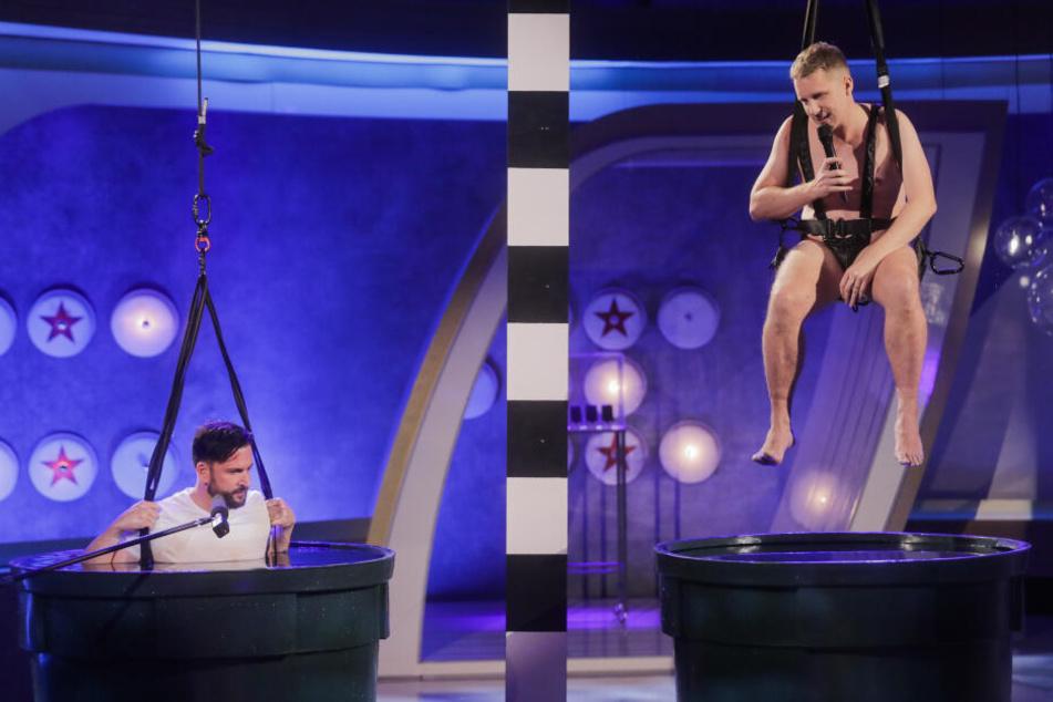 """Oliver Pocher (r), Moderator, und Michael Wendler, Sänger, treten in der Live-Show """"Pocher vs. Wendler - Schluss mit lustig!"""" bei RTL gegeneinander an."""