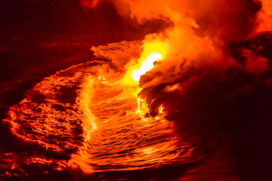 Lava flows into the ocean from Kilauea in a previous eruption.
